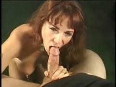 Elle Devyne giving some guy a good blowjob.