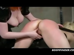 Latex redhead whips spanks paddles and electro stimulates her submissive blonde lesbian