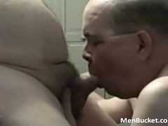 dudes sucking on the leather pipe