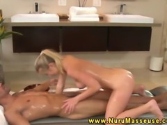 Blonde masseuse babe gives dude oily masage after blowjob