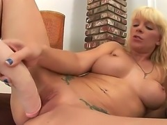 Busty blonde hottie Heidi Mayne enjoys ravaging her tight pussy with her huge dildos in amazing solo