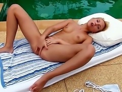 Nataly Von is fresh and young blonde with great fucking ambitions. She enjoys fucking in front of the camera but today she remains dickless thats why she starts to use her fingers.