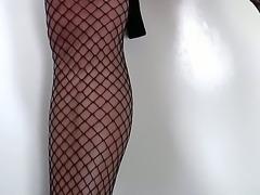 Handsome brunette transvestite chick TS Gina Hart is passionately jerking her big dick until gets cumshot.