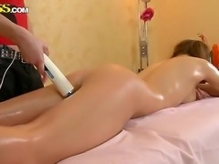 Pigtailed cutie Lara gets tough massage session, and she has her body oiled well and her anal fucked rough