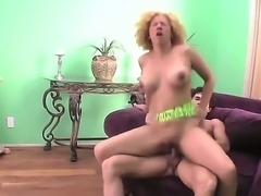 Big ass blonde milf Michelle Honey with curly hair and natural juicy knockers rides on her horny lover and gets rammed from behind until her cums on her balloons in living room.