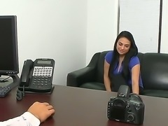Busty brunette Rikki Nyx goes to a porn casting where she starts to get naked