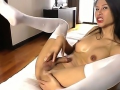 This ladyboy lies back in her comfy bed, her semi-hard cock nestling against her belly button, and shes thinking one thing: should I get it fully hard and jerk for the camera