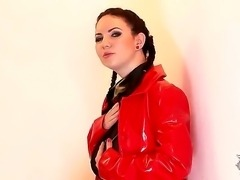 The awesome brunette Karina Heart in red latex caresses her tits and sweet nipples