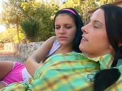 Erotic lesbian couple Mara and Mia outdoors having some lesbian make out session
