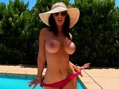 Voluptuous Jayden Jaymes is getting awfully horny as she squeezes her perky nipples by the poolside