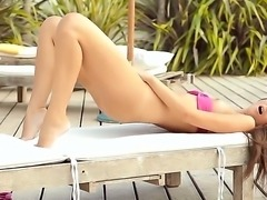 The wonderful and gentle babe Bianca with athletic body masturbates her pussy near the pool