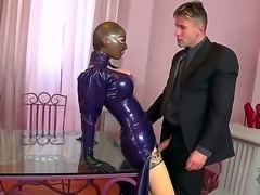 It is hard to read the expression on Latex Lucys face, but it is still possible to know what she thinks by the way she breathes. The man, who fucks, her is happy to know that she likes it.
