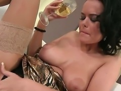 The sympathetic brunette whore with a medium natural tits plays with her wet pussy