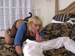 Magnificent  Milf blonde Mellanie Monroe is having a good sex with tattooed guy, sucking his big dick and making him sniff and enjoy her horny pussy trough her dark stockings.