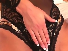 Brunet slut in sexy lingerie is petting her jelly bean through the panties