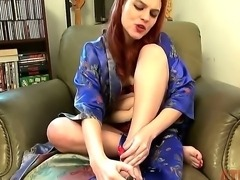 Cute redhead slender girl Andrea Skye excitingly taking off her sexy robe ant sliding down panties to demonstrate how she masturbates cunt with vibrator.