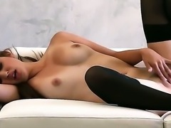 Sweet-looking brunette girl Natasha Malkova stays in black stockings and black high heeled shoes. Chick starts playing with magnetic fresh pussy after posing for a while.