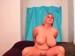 Ebony dude is relaxing with sexual BBW chick April McKenzie. The blondie is giving nice fellatio to man before spreading legs and feeling the huge chocolate penis into cunt.