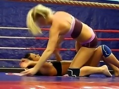 Blonde and brunette topless girls are wrestling in this exciting scene. They both look amazing and now you should just relax looking at them wrestling to feel so excited.
