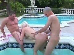 Turned on steaming hot blonde whore Kelly Taylor with firm fake tits and heavy make up gets fucked hard by couple horny handsome studs in hardcore outdoor session by the jacuzzi.