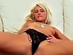 Blonde girl with nice fresh forms of body is taking off her black panties and staying in black high heeled shoes before starting to masturbate. Watch her fingering.