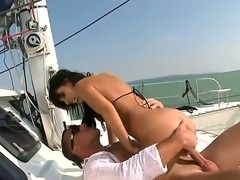 Brigitte Fox enjoys her holidays with her husband. The couple goes to the sea trip on the yacht where they have amazing sex with blowjob and spectacular cumshot at the end.