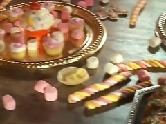 The whole of this table is loaded with sweets but fairy tale honeys Ash Hollywood and India Summer are only interested in one lollipop. The one hiding in their buddys pants!