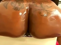 Sweet ebony chick named Carmen Hayes shows her delicious and oiled ass