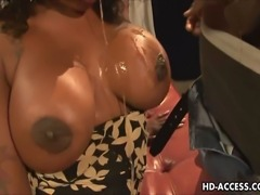 This hot black babe has great big tits and a sexy ebony booty. We see her in action sucking her guy before he fucks her hard, her sexy ass wobbling with delight.