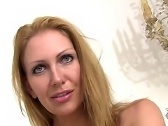 Pretty blonde Leigh Darby strips off her dress to reveal her busty tits and sexy shaved beaver