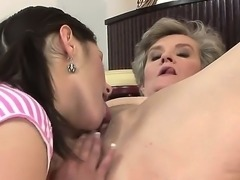 Brunette hot lesbian babe Connie licks a horny granny Aliz boobs and muff skillfully as she moans