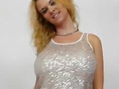 Bosomy cutie masturbates her pussy with panty-hose