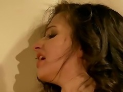 Beautiful dark haired lady Ann Marie La Sante gets bondaged in the dark room by her boss
