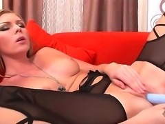 Turned on blonde Ulrika with heavy make up and hot body in kinky black lingerie and high heels polishes shaved wet fish lips and plays with long blue vibrator.