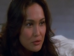 Tia Carrere showing some nice cleavage in a low-cut dress and various bikinis during a few hot scene. From Waynes World.