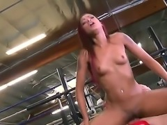 Attractive redhead Skin Diamond with cheep tattoos and hot body seduces tall young stud Cody Sly and enjoys riding on his cock in the gym to loud wet orgasm.