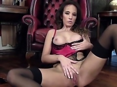 Seducing and arousing brunette babe Jemma Perry in pink and black lace lingerie and stockings teases and fingers her shaved taco on the floor and all over the living room