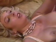 Busty retro babe Victoria Paris and Peter North fucks around the living room. Victoria takes the cum kings cock and keeps asking for more.