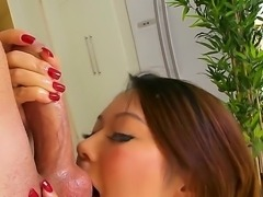 Seductive experienced asian milf Tiger Benson with perfectly shaped round ass and huge jaw dropping knockers in corset and stockings teases younger lever and fucks with him like crazy.