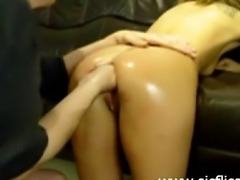 Amateur blond slut gets a hard fist fucking from behind in her loose cunt