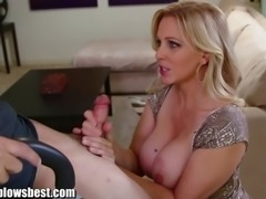 Busty MILF Julia Ann is sucking on a boy's cock while he is tied, upside down!