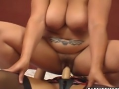 Busty babes Mellie D & Jessica Monroe sucking on each other huge melons then Jessica pounds Mellie D with a strapon dildo