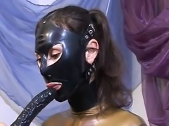 Horny domina in sexy black boots using sex toys to satisfy her needs