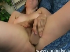Silva Storey slips in a large rubber dick into her hairy scary snatch and fucks her pussy till it gets wet and satisfied. This video is brought to you by Auntjudys.com