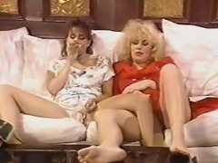 Busty brunette Christy Canyon teams with a blonde babe for steamy lesbian sex. The contrasting looks make for some hot pussy licking.