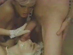 John Holmes takes the Roman Empress to the home of babe Amber Lynn for a hot threesome. John gets off fucking both sexy chicks.