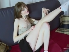 Vasilisa stretches out her long ermine body on the couch and fingers her hairy pussy, while giving you horny come hither eyes to slip one between the pussy lips.