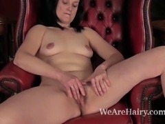 Hairy woman Emily Marshall is a mature hairy woman. She loves her hairy pussy and she wants to share her pleasure. She enjoys making her first video, showing how she masturbates her hairy pussy.