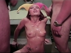 This woman may wear a funny hat but she absolutely loves drinking and being bathed in hot sperm.