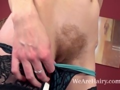 Hairy girl Josselyn is a sexy brunette babe in silky black stockings and sexy lingerie. She slowly strips naked and then uses a sleek pink dildo to slide in and out of her wet hairy pussy.